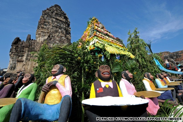 Wooden monkeys surround an ancient templ